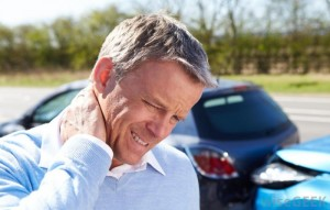 man-rubbing-neck-after-car-wreck-700x446